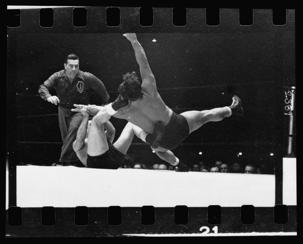 Two men wrestling with a referee nearby. Stanley Kubrick.