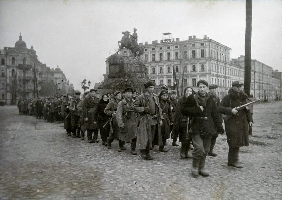 Soviet partisans marching in Kiev, 1943.