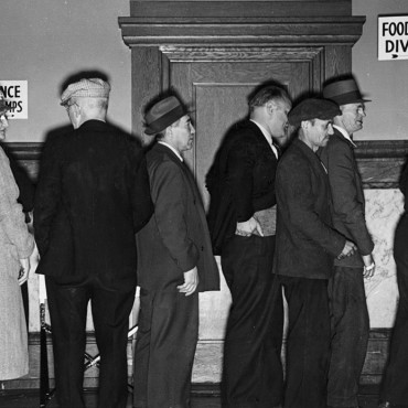 Applicants for food stamps wait in line in Rochester, New York. National Archives and Records Administration