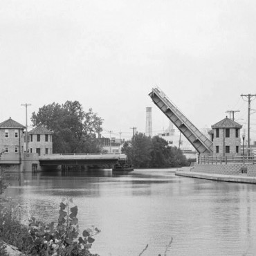 A bridge spanning a government canal in Menasha, WI. John Vogel / Library of Congress