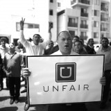 Uber drivers protest their working conditions outside the company's Santa Monica, California office last June. Lucy Nicholson / Reuters