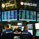 Traders work at the Barclays booth on the floor of the New York Stock Exchange. Scott Eells / Bloomberg