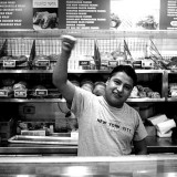 A worker behind the counter at Hot and Crusty. Eleazar Castillo / HFI Films.
