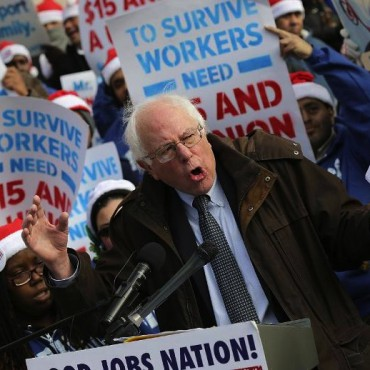Sen. Bernie Sanders speaks to low-wage federal contract workers demanding presidential action to win a $15-an-hour wage on Dec. 4, 2014. Win McNamee / Getty