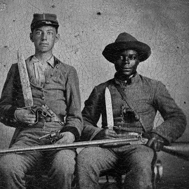 Sergeant A.M. Chandler of the 44th Mississippi Infantry Regiment, Co. F., and Silas Chandler, a family slave who accompanied two Chandler brothers during their military service in the Civil War.