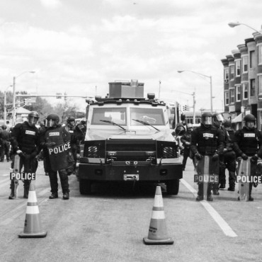 A police barricade around the time of the Baltimore Uprising last spring. James Jamieson / Flickr
