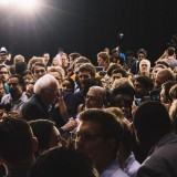 Bernie Sanders wades into the crowd after a campaign rally last summer. Sam Bartlett / Flickr