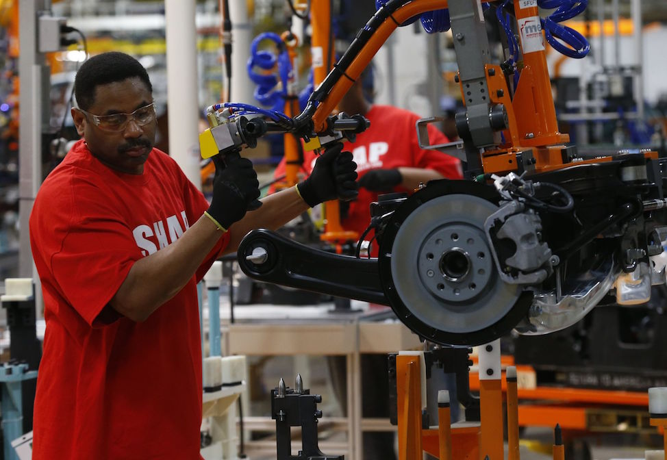 An autoworker at Chrysler's assembly plant in Sterling Heights, Michigan.  Paul Sancya / AP