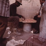 Workers on Chicago's South Side play checkers before going to work in May 1973. The US National Archives / Flickr
