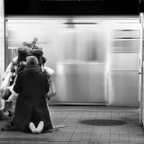 A homeless man in a New York City train station. Euan / Flickr