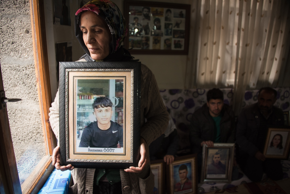 A mother holds the portrait of her missing son in Diyarbakir's Dicle Firat Cultural Center on March 16, 2016.