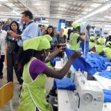 Hillary Clinton visiting the Sae-A garment factory at Caracol Industrial Park in Haiti, in 2012. USAID / Flickr