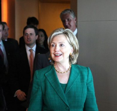 Hillary Clinton entering a press briefing in 2010. US Department of State / Flickr