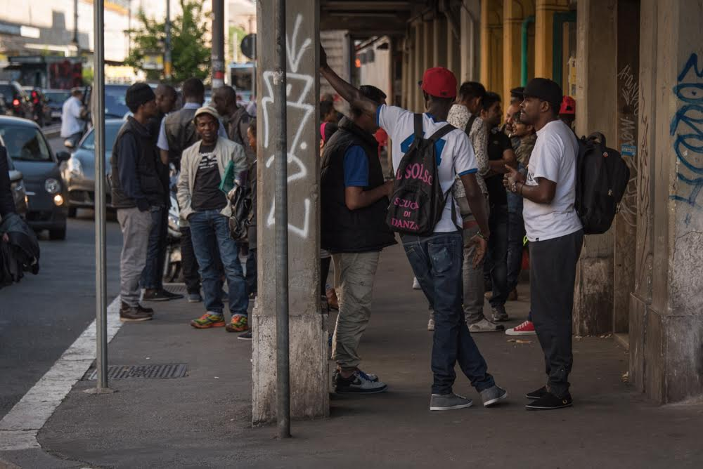 Young men gather near the Central train station in Rome, an area known for its cheap hotels. Diego Cupolo / Jacobin