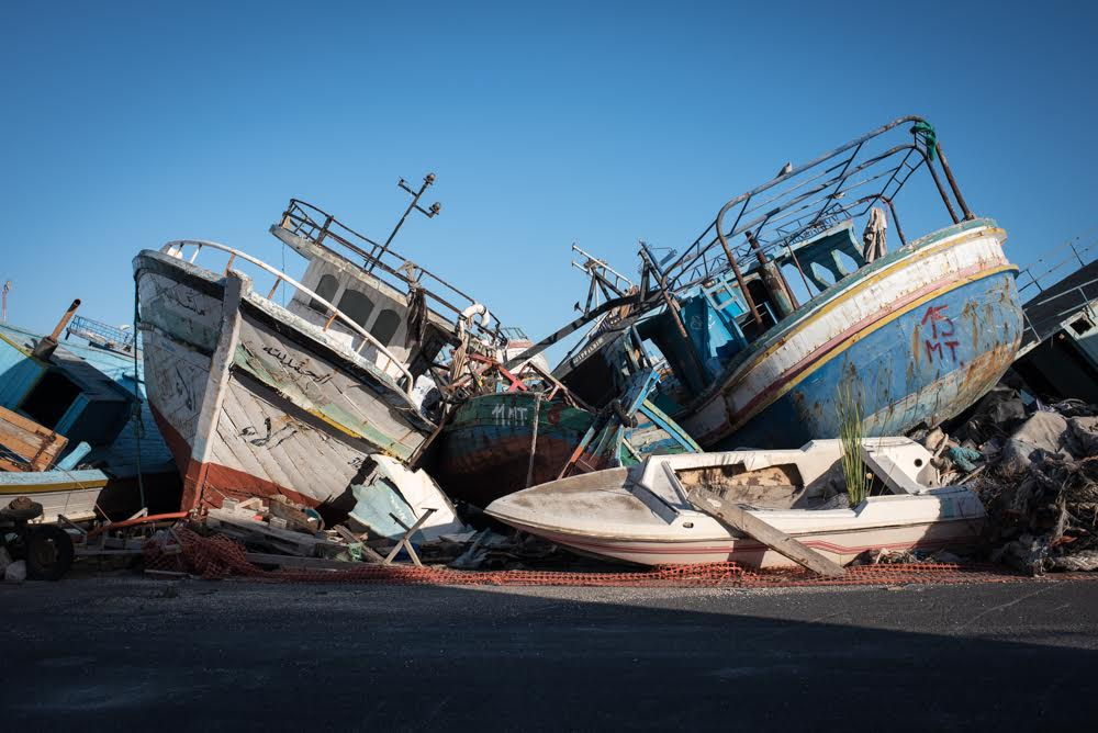 Boats used by asylum-seekers collected at the Pozzalo port in Sicily. About 222,000 people have smuggled themselves into Europe since the beginning of 2016, and Sicily has been the main gateway in recent months. Diego Cupolo / Jacobin