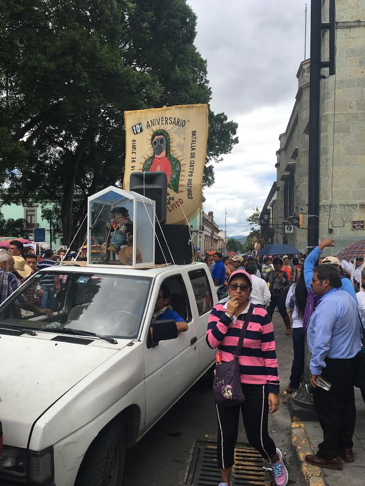"Protesters carry a banner featuring ""The Virgin of the Barricades"" on June 14, 2016 to commemorate the ten-year anniversary of the Oaxacan social movement. Shane Dillingham / Jacobin"