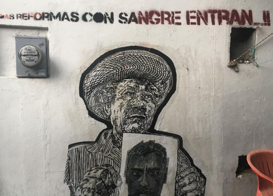 """The reforms are introduced with blood,"" mural in Oaxaca, Mexico in 2016. A. S. Dillingham"