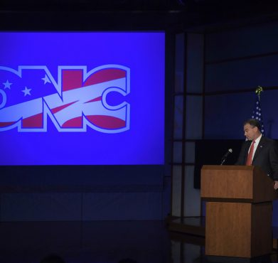 Tim Kaine revealing the DNC's (awful) new logo in 2010. Cliff / Flickr