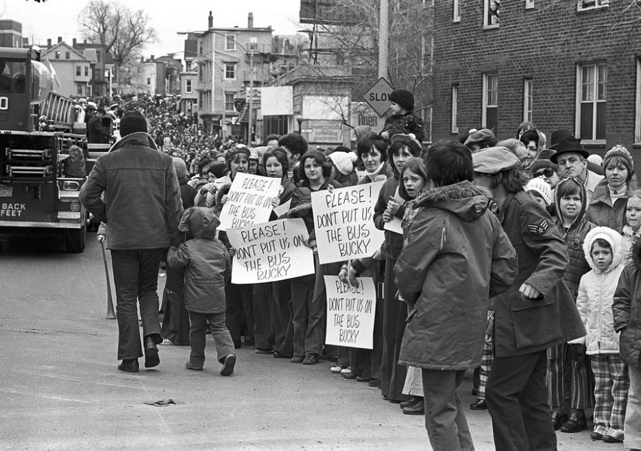 Anti-busing signs at the St Patrick's Day Parade in South Boston in 1974. Spencer Grant / Boston Public Library