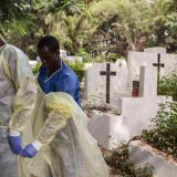 Volunteers assist with the burial of Ebola victims in Guinea in January 2015. UN Photo / Martine Perret