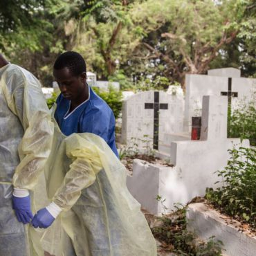 Volunteers assist with the burial of Ebola victims in New Guinea in January 2015. UN Photo / Martine Perret