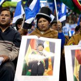 Activists and indigenous community members hold pictures of Evo Morales in Cochabamba, Bolivia in July 2013. Cancillería del Ecuador / Flickr