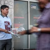 A Morena supporter hands out literature in Mexico City. Eneas de Troya / Flickr