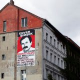 A mural depicting murder victim Enver Şimşek in Berlin. Bernd Sauer-Diete / Flickr