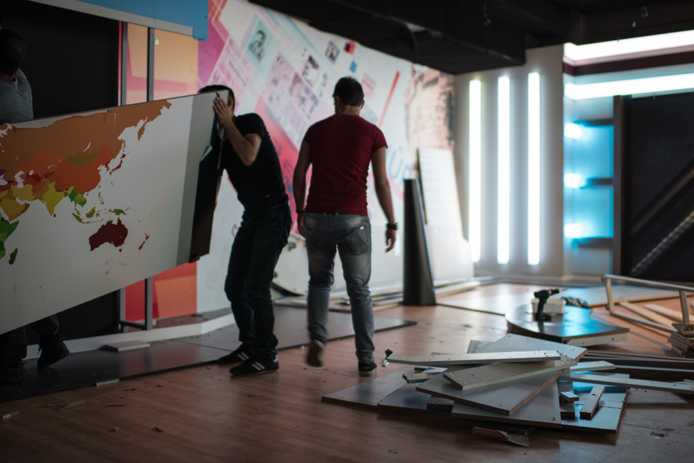 Workers dismantling the Ozgur Gun TV studio in Diyarbakir after the station's satellite broadcasting abilities were abruptly cut in late August. Diego Cupolo / Jacobin