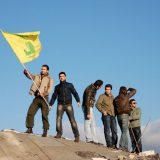 Men posing with the Hezbollah flag in Khiam, Lebanon. Paul Keller / Flickr