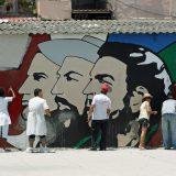 Repainting a revolutionary mural in Havana. Carsten ten Brink / Flickr