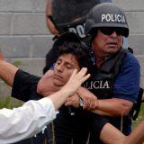 Police restrain a protester in Palmerola, Honduras in 2011. Felipe Canova / Flickr