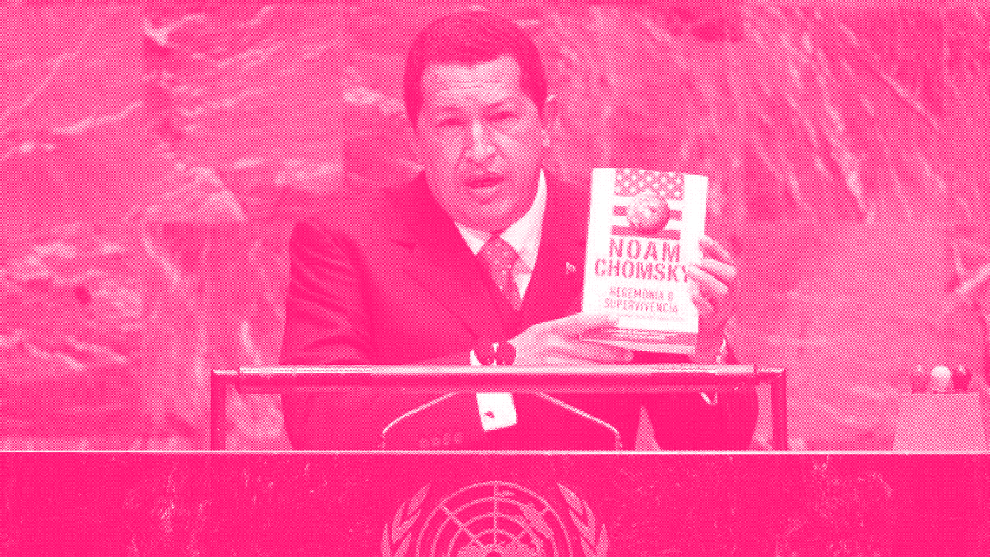 Hugo Chávez holds up a book by Noam Chomsky