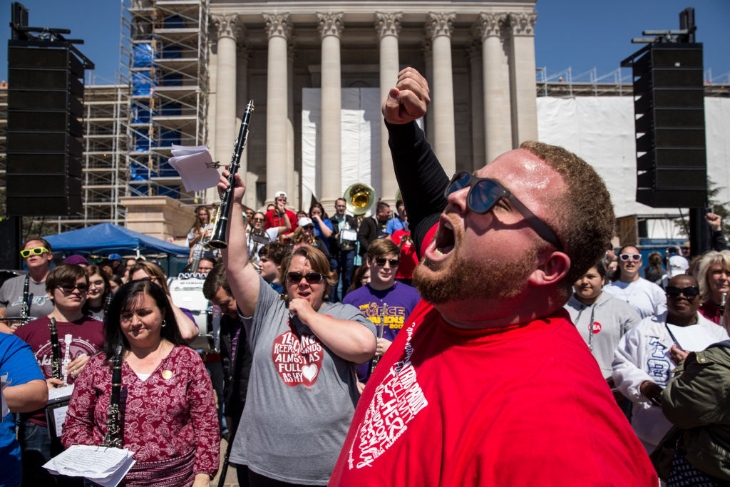 7562685444dd Putnam City West band director Edward Hudson leads the The Oklahoma Teacher  Walkout Band