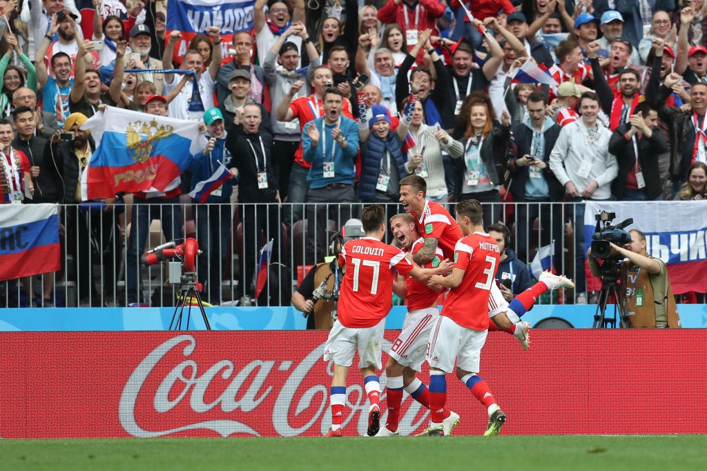 Iury Gazinsky of Russia celebrates with teammates after scoring the opening  goal during the 2018 FIFA World Cup Russia Group A match between Russia and  ... 3f4e88be677d0